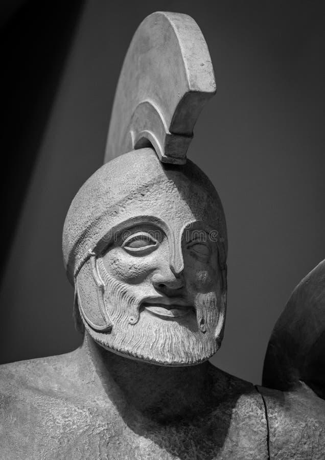 Head in helmet Greek ancient sculpture of warrior stock images