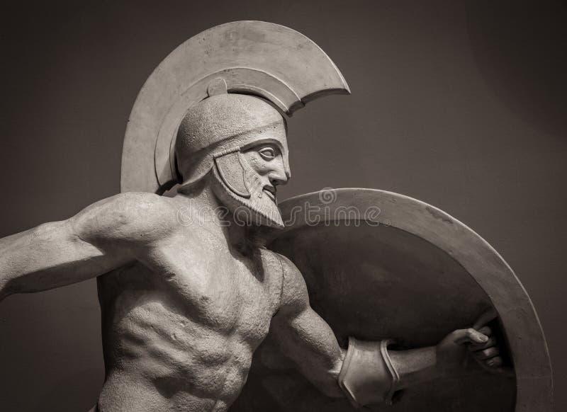 Head in helmet Greek ancient sculpture of warrior stock photography