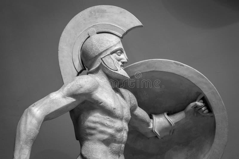 Head in helmet Greek ancient sculpture of warrior stock image