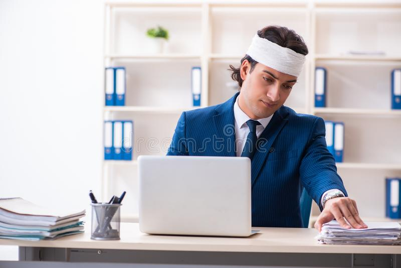 Head injured male employee working in the office stock photos