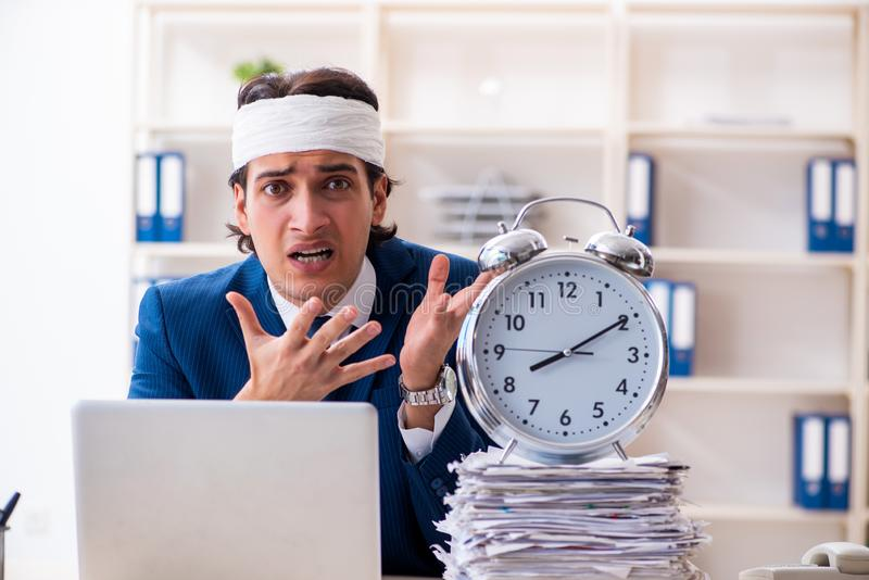 Head injured male employee working in the office royalty free stock photography