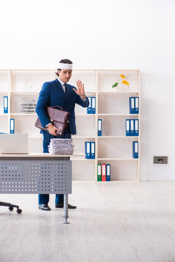 Head injured male employee working in the office stock photography