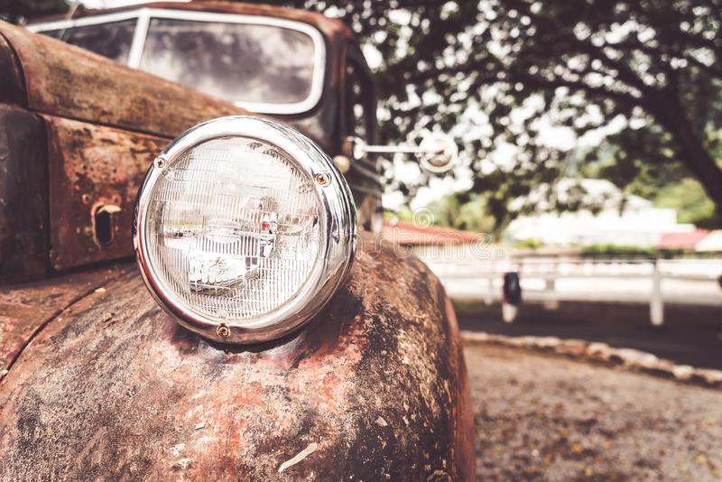 Head light of old car. Vintage effect filter royalty free stock image