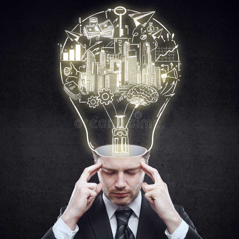 Head människa för lampa mot begreppsmässig bakgrund royaltyfri fotografi
