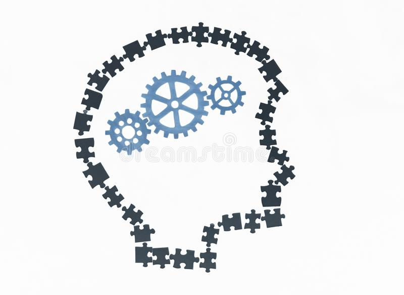 Head of a man is piled up in a head gears on a white background. Idea generation business concept stock illustration