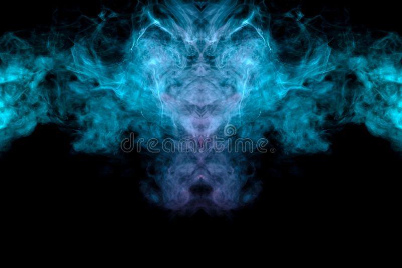 The head of a monster with a skull in the form of a pattern from a ghost or a mystical creature from green and pink smoke on a. Black background. Print for stock photo