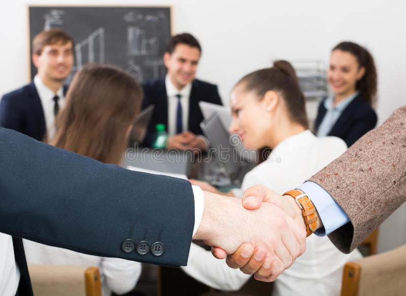 The head of office greeting young team member stock photography