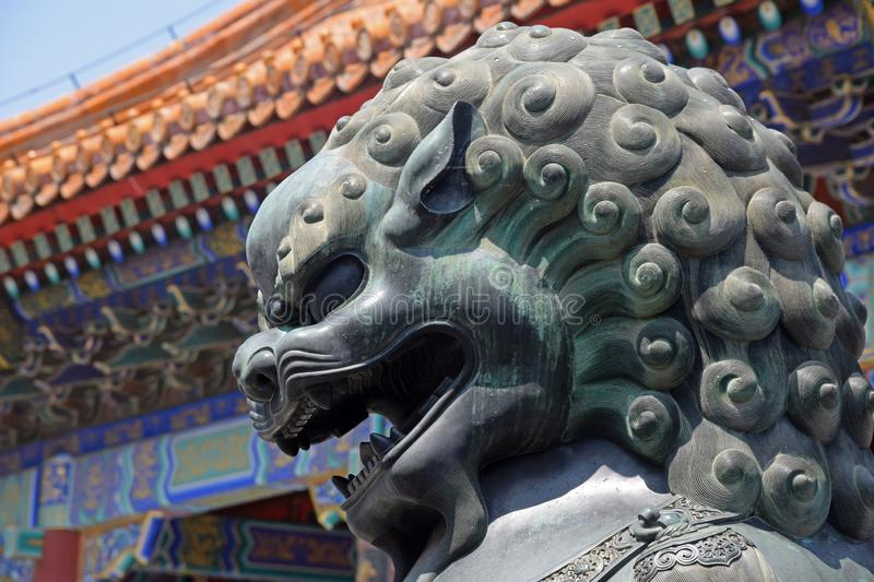 Head portrait of bronze Chinese guardian lion statue royalty free stock photo