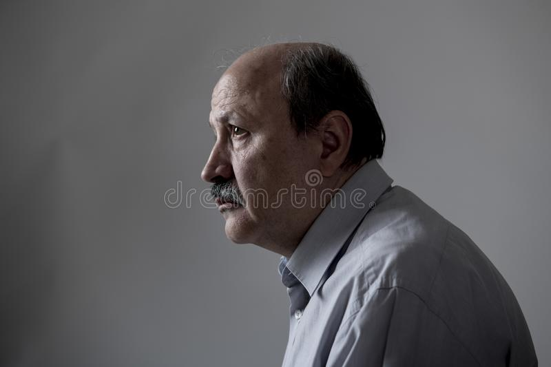 Head portrait of senior mature old man on his 60s looking sad and worried suffering pain and depression in sadness face expression royalty free stock images
