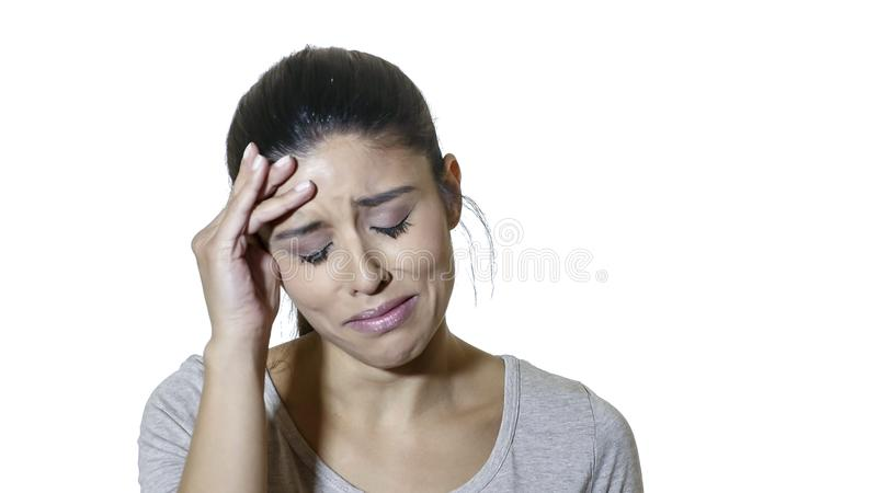 Head portrait of young attractive and beautiful sad latin woman suffering pain and depression feeling stressed and negative isolat. Head portrait of young royalty free stock images