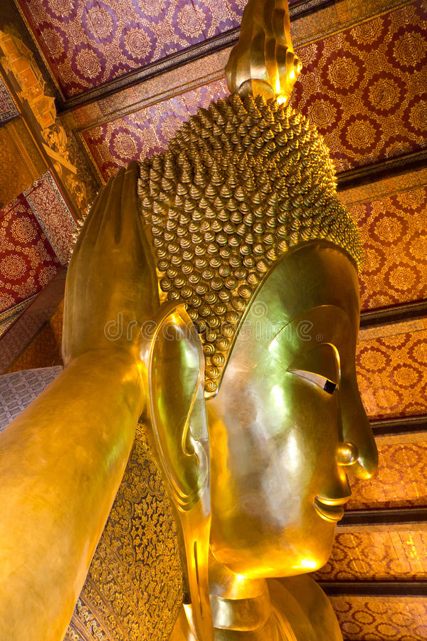 Head of Reclining Buddha, Bangkok royalty free stock photo
