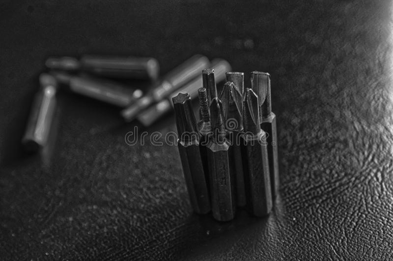 Head for screwdriver bits on blue background, Tools collection turn-screw royalty free stock photo