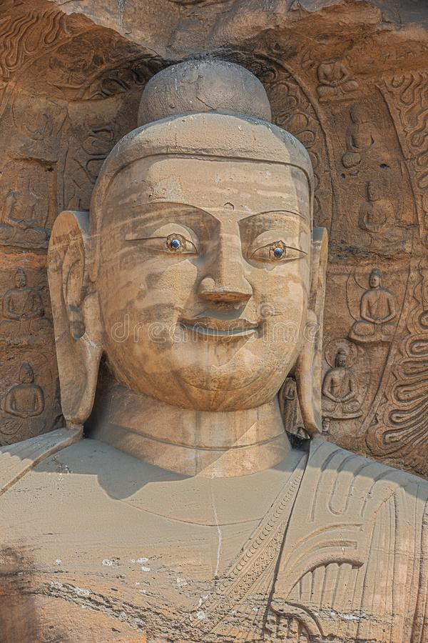 Head shot of a Buddha statue in a niche in the Yungang Grottoes. Near Datong stock photos