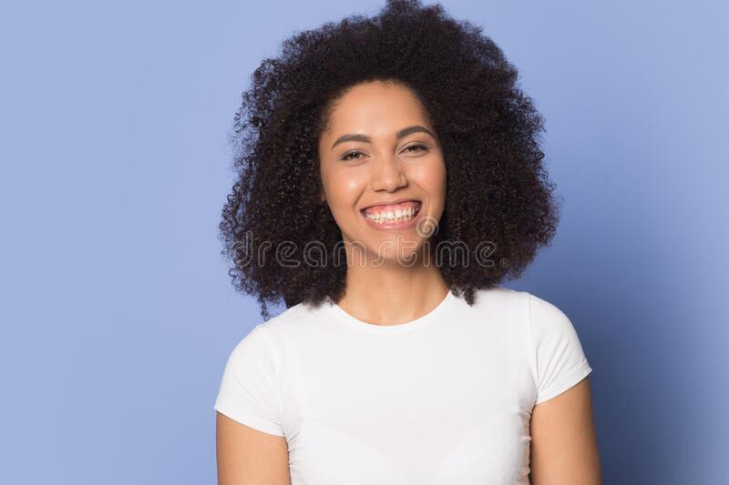 Smiling happy attractive african american millennial lady feeling overjoyed. royalty free stock photos