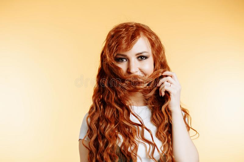 Portrait of beautiful redhead girl with long hair royalty free stock photo