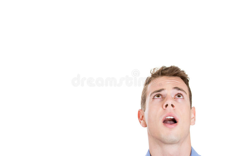 Head shot of handsome man daydreaming, looking up and to side royalty free stock photography