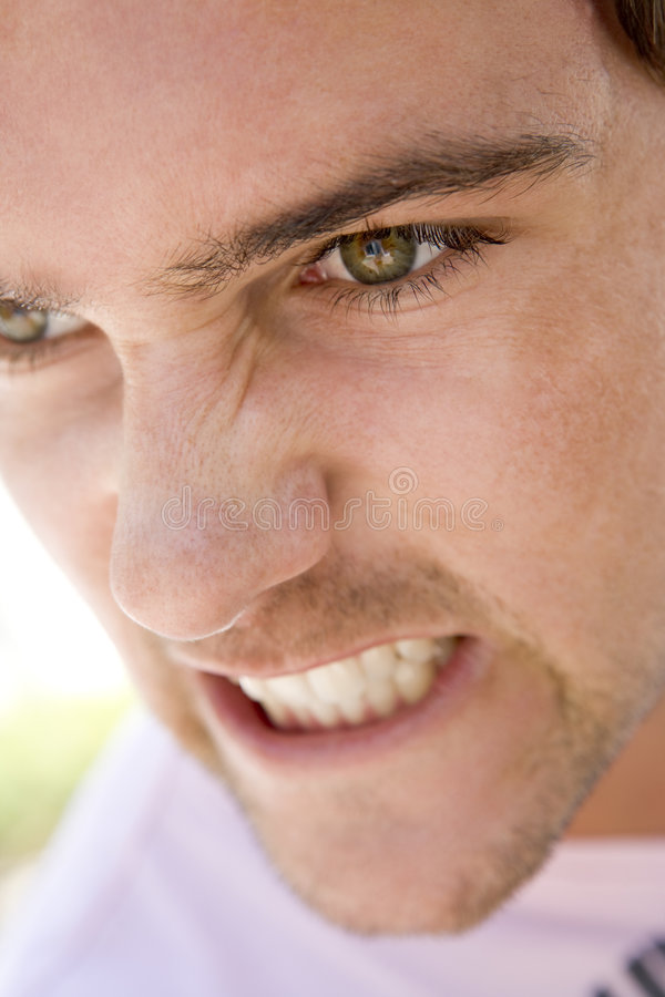 Download Head shot of man scowling stock photo. Image of outdoors - 5944806