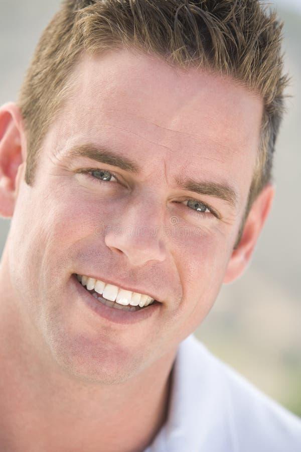 Head shot of man smiling stock image