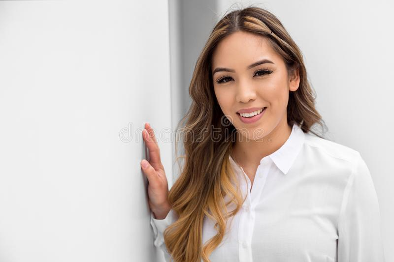 Head shot of a mixed ethnicity young hispanic woman, smiling genuine lifestyle portrait on white background stock photos