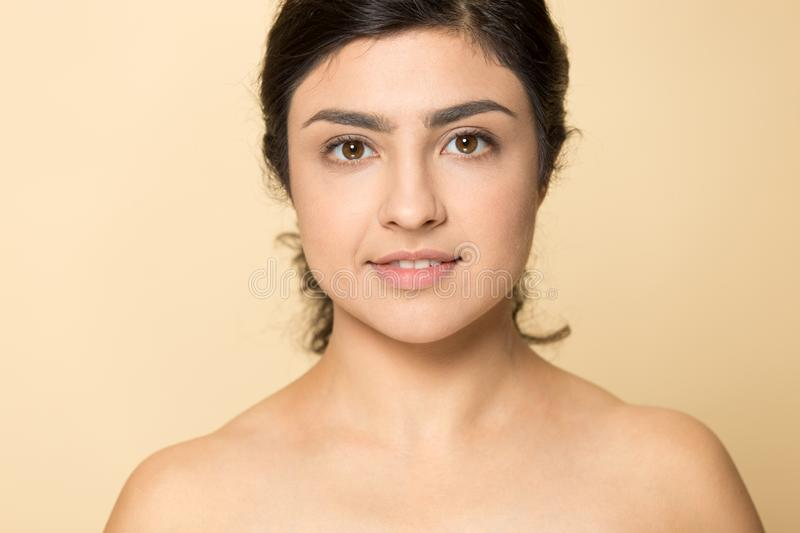 Head shot portrait beautiful Indian young woman with naked shoulders royalty free stock photography