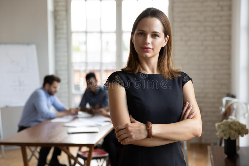 Head shot portrait confident beautiful businesswoman with arms crossed royalty free stock image