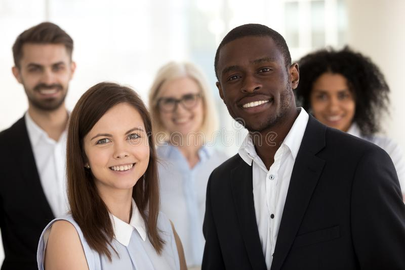Head shot portrait of excited smiling diverse employees in office stock photography