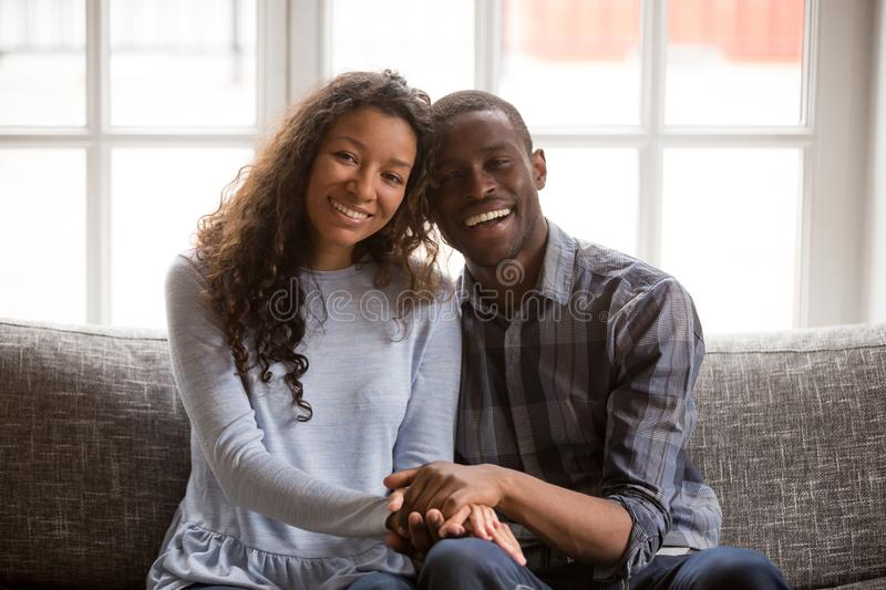 Head shot portrait happy African American couple in love sitting royalty free stock photography