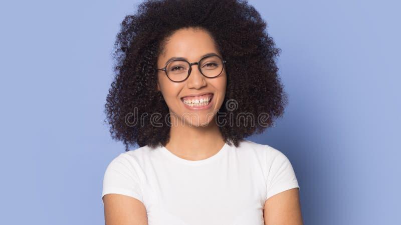Head shot portrait happy beautiful African American girl wearing glasses stock photography