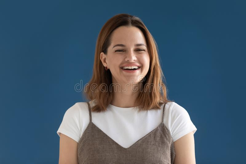 Head shot portrait happy laughing woman looking at camera stock images