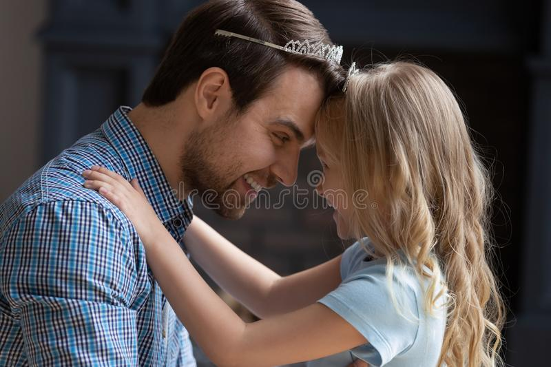 Head shot portrait overjoyed young dad playing with daughter. stock images