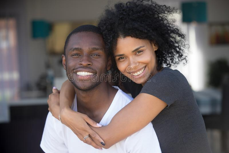 Head shot portrait of smiling African American couple in love stock photography