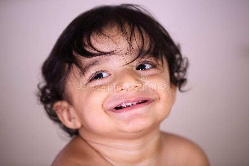 Head shot of smiling baby boy royalty free stock photos