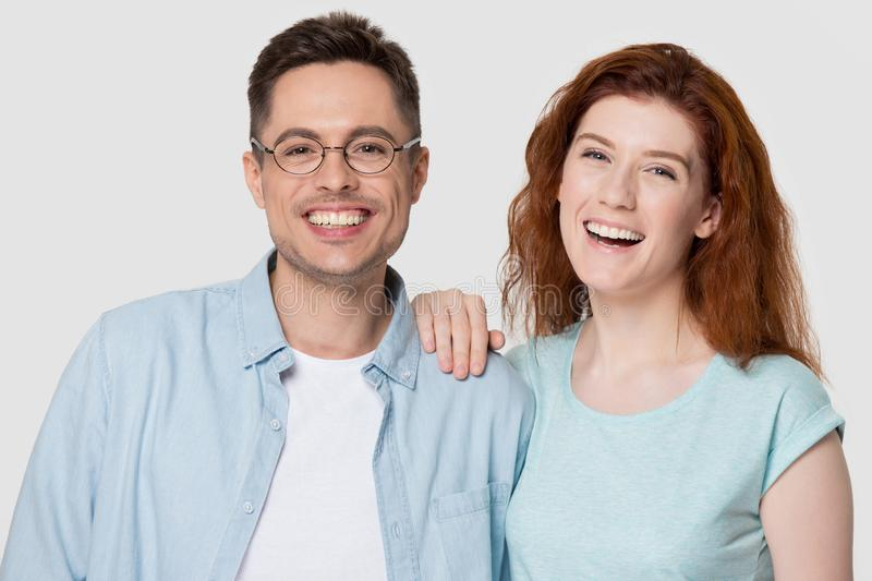 Head shot studio portrait attractive laughing millennial couple studio shot royalty free stock photography