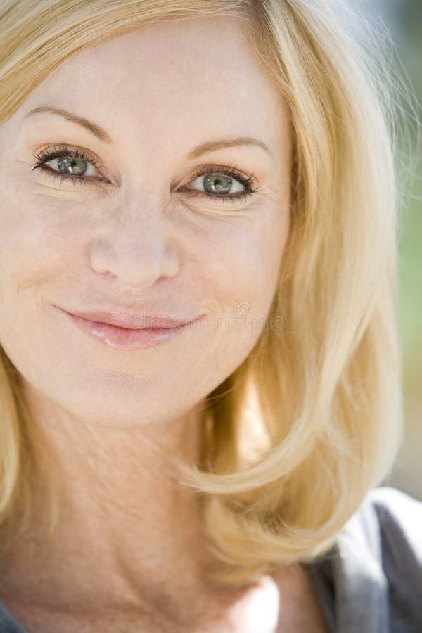 Head shot of woman smiling stock photos