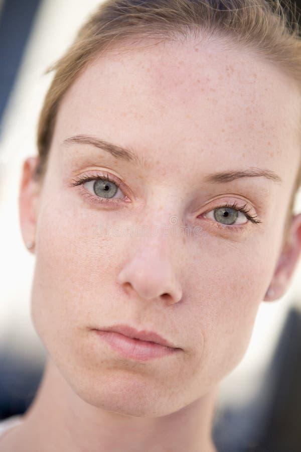 Head shot of woman thinking. Looking at camera royalty free stock photo