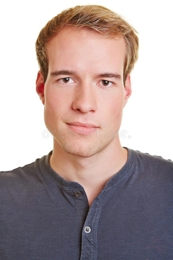 Head shot of young man. Neutral frontal head shot of a young attractive man stock photos