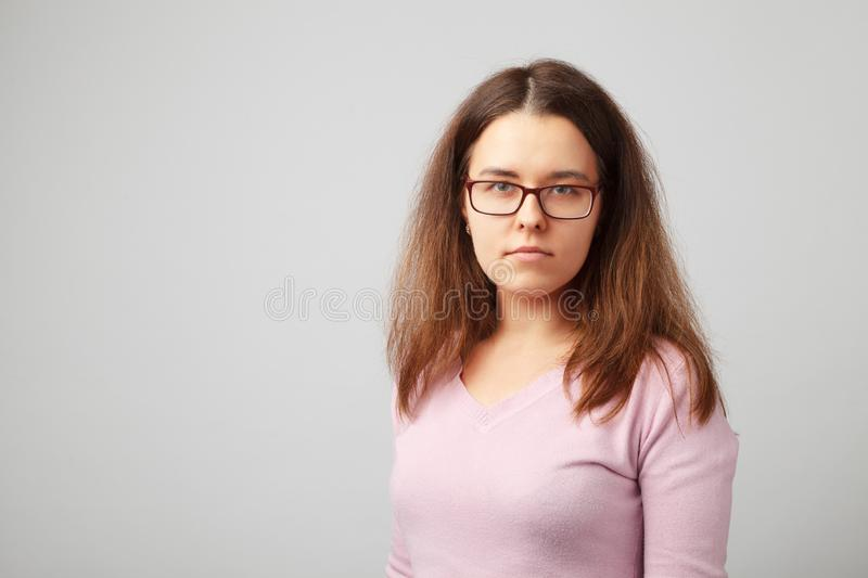 Head and shoulder portrait of brunette young woman with glasses stock photography