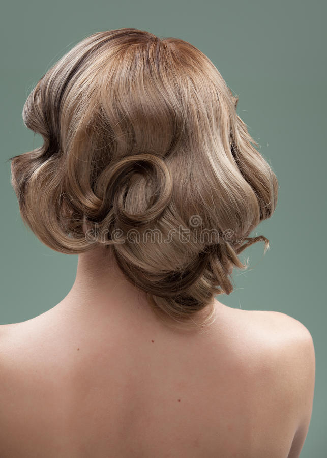 Head and shoulders back image of a young woman royalty free stock photo