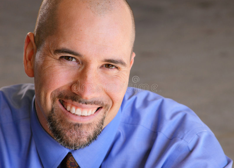 Head and shoulders of man smiling royalty free stock image