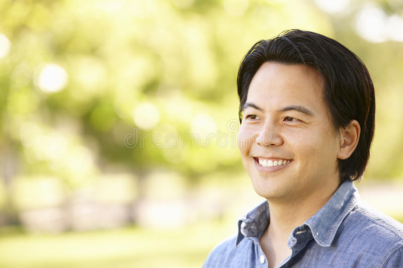 Head and shoulders portrait Asian man outdoors stock images