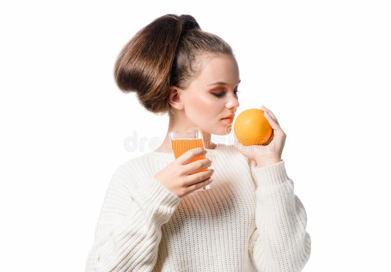 head and shoulders portrait of attractive beautiful young caucasian woman isolated on white studio shot drinking orange juice royalty free stock image