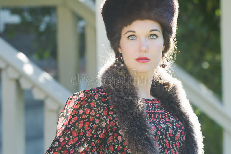Head and shoulders portrait of Russian beautiful woman wearing fur Cossack hat and fur collar royalty free stock photos
