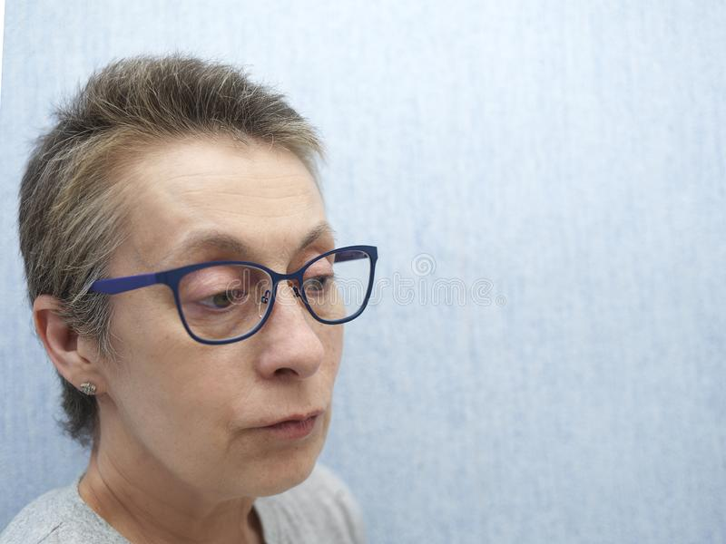 Woman in glasses and short hair stock photos