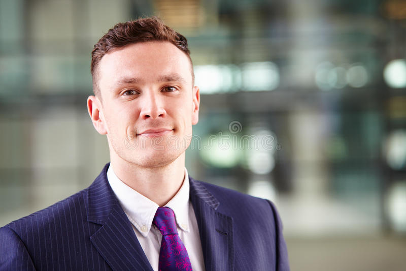 Head and shoulders portrait of a young Caucasian businessman stock image