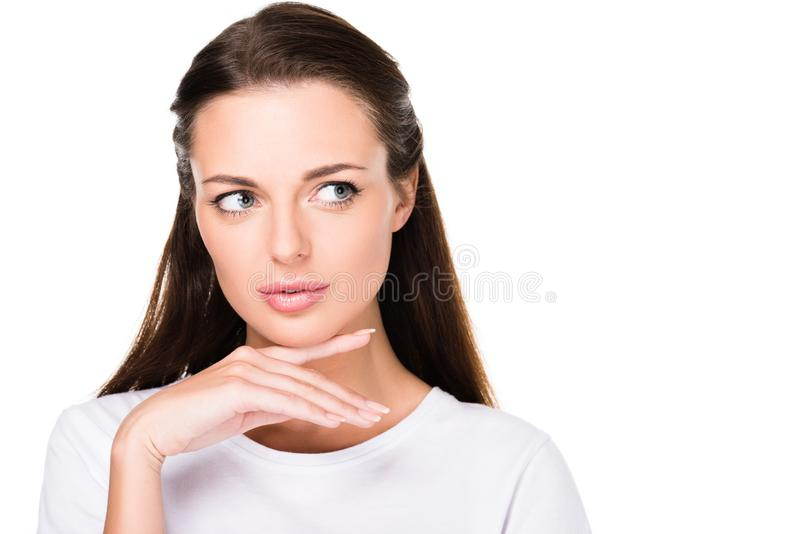 head and shoulders shot of attractive thoughtful woman looking away royalty free stock photo