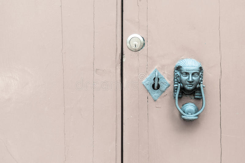 Head of the Sphinx, and key in the lock. Green version stock photo