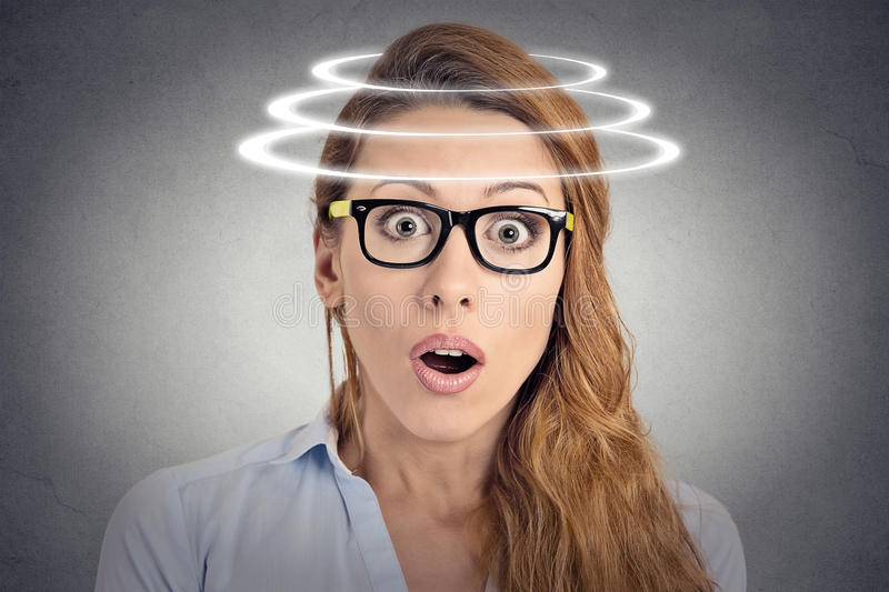 Head is spinning. Shocked woman with vertigo royalty free stock images