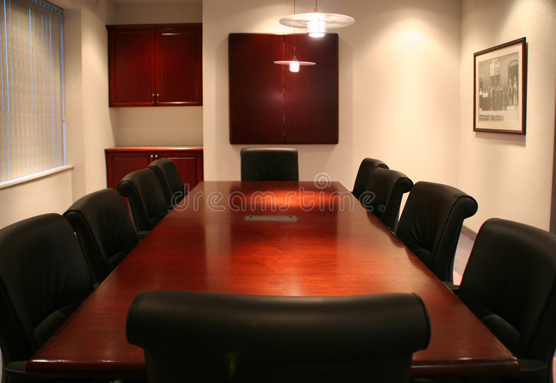 Head of the table. High quality picture of a corporate boardroom at a head office royalty free stock photo