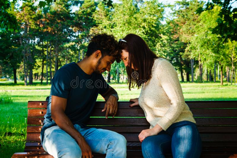 Head to head domination game. Interracial couple in a head to head gesture, female domination gesture stock images