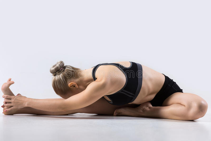 Head-to-Knee forward bend pose stock images